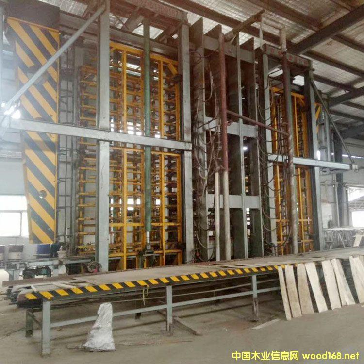 9成新青岛国森产十五层2600吨二手人造板热压机